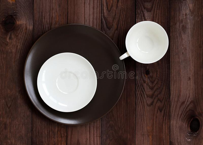 Dish saucer cup stacked on a dark background royalty free stock images