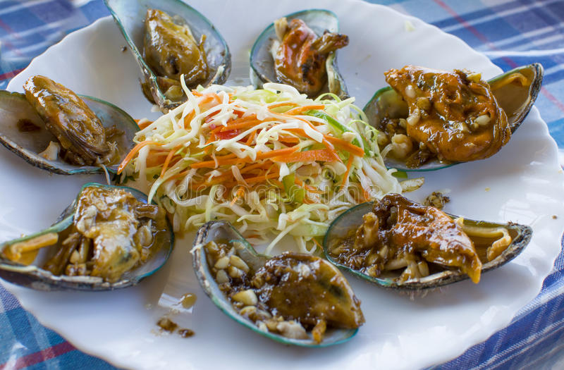 Dish from sea products in sauce mollusks. Dish from sea products sauce mollusks stock images