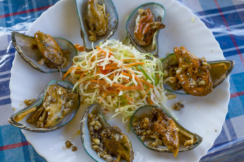 Dish from sea products in sauce mollusks. Dish from sea products sauce mollusks royalty free stock images
