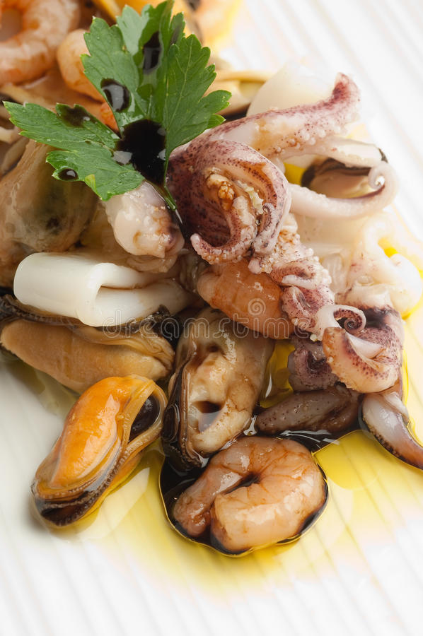 Dish with seafood salad stock photo