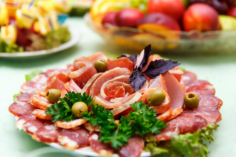 Dish with sliced meat products. On the festive table royalty free stock photography