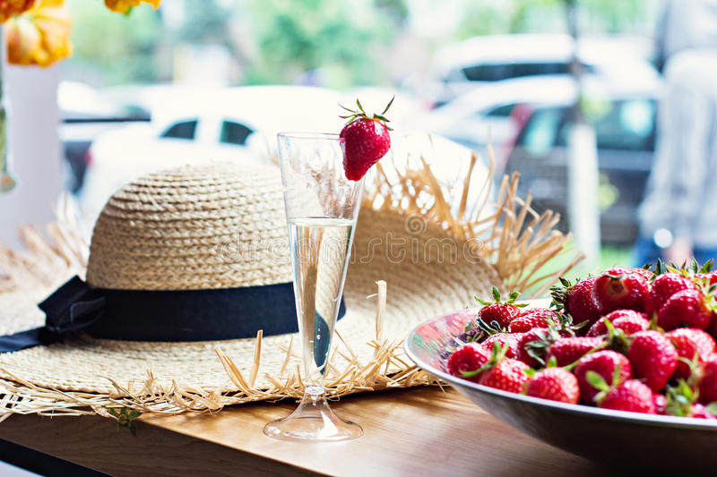 Dish with strawberries and champagne glasses on the table. stock photo