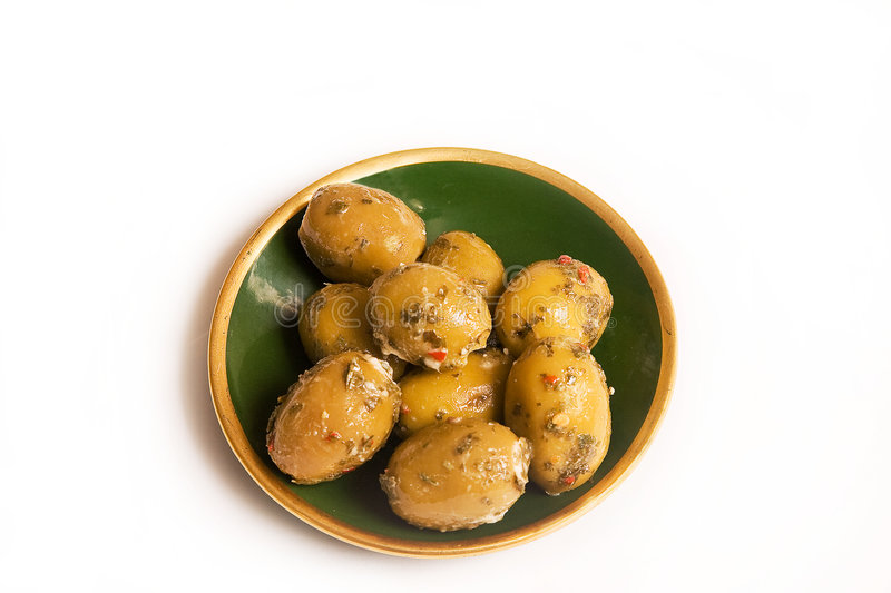 Dish of stuffed Olives. Dish of large stuffed olives with herbs stock photos