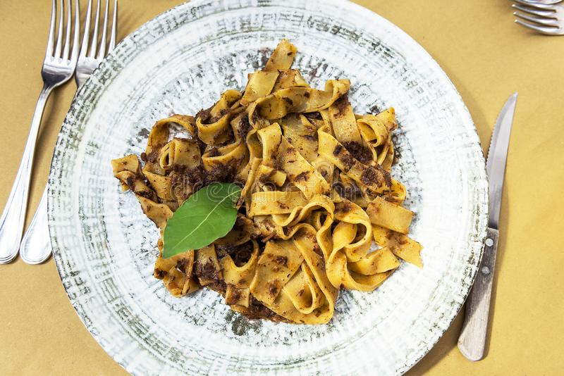 Dish with tagliatelle with wild boar meat sauce stock images