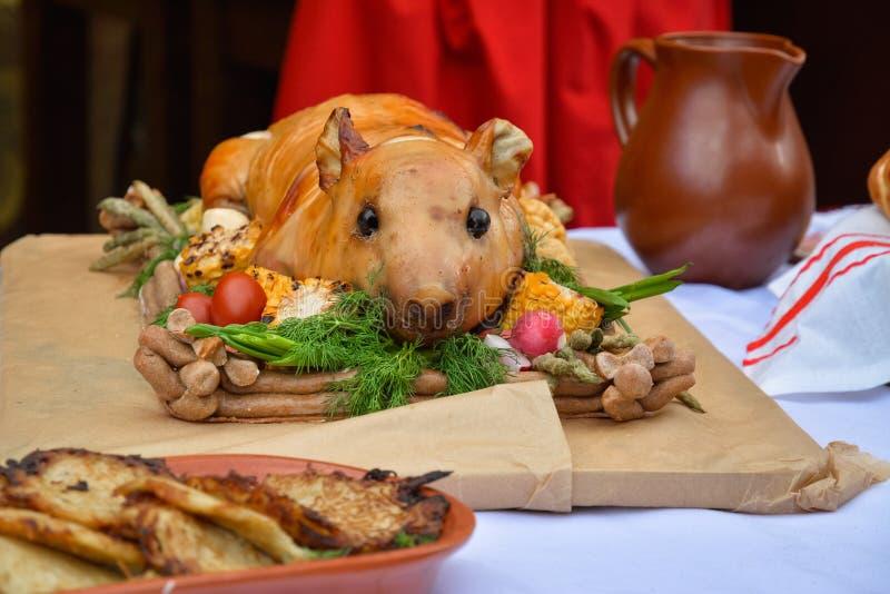 Dish of Ukrainian cuisine - fried dairy pig.  stock photo