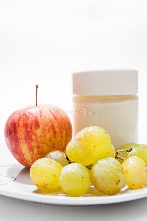 Dish with yogurt, apple and grapes