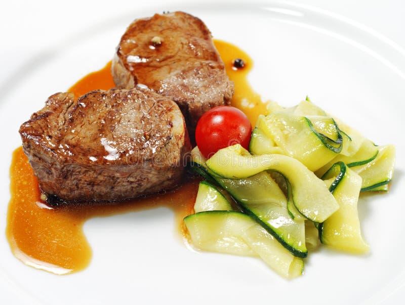 dishes горячая телятина медальонов мяса стоковые изображения