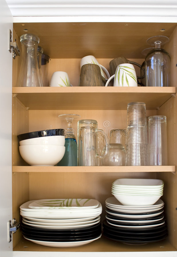 Dishes in the Cupboard royalty free stock photo