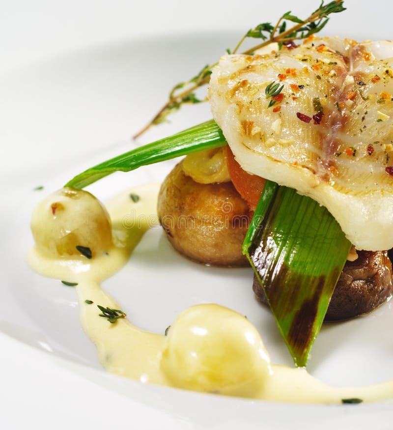 dishes fillet fish halibut hot arkivbild