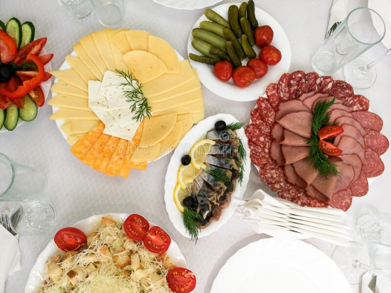 Dishes and fish salads on the festive table royalty free stock photography