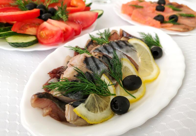 Dishes and fish salads on the festive table royalty free stock photos