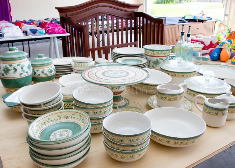 Dishes at garage sale stock image