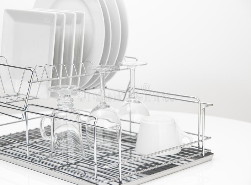 Dishes and glasses drying on metal dish rack royalty free stock images