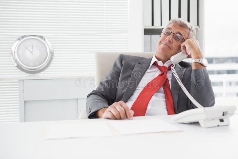 Disheveled businessman on the phone stock image