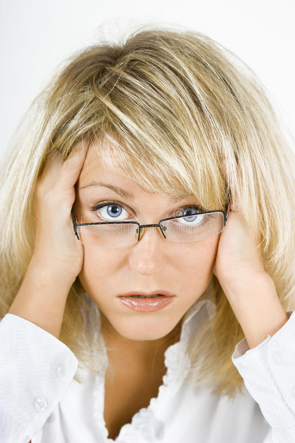 Disheveled girl in glasses. Disheveled, distraught young blonde girl with glasses stock photos