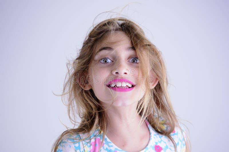 Disheveled happy girl. A little girl disheveled happy stock images