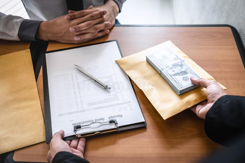 Dishonest cheating in business illegal money, Businessman giving bribe money in envelope to business people to give success the royalty free stock image