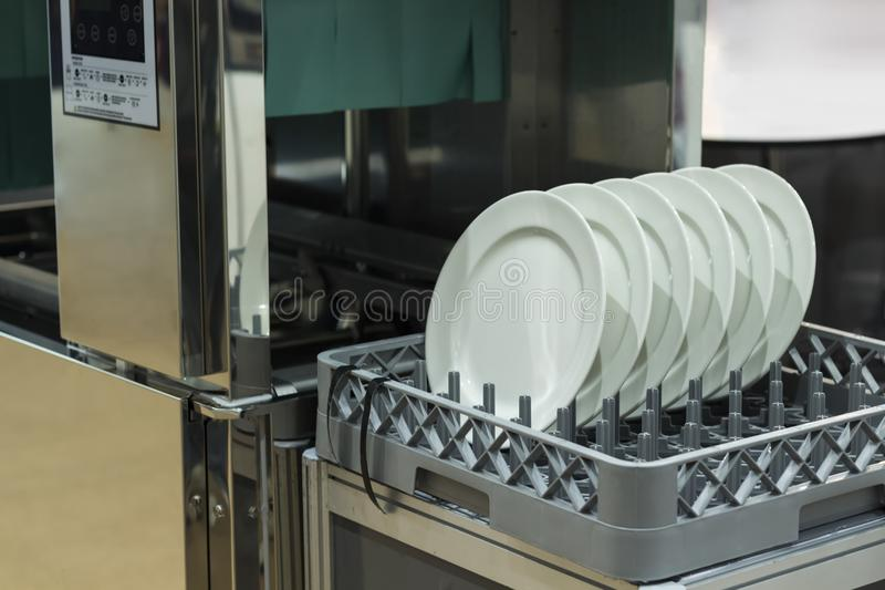 dishwasher with clean dishes stock photos