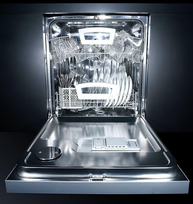 Dishwasher. Image is posed on dark background royalty free stock image