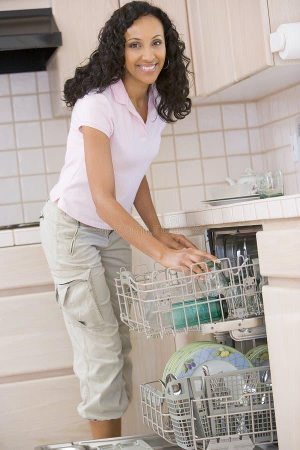 dishwasher loading woman στοκ εικόνες