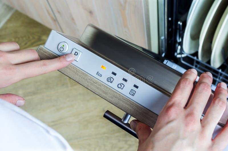Dishwasher machine. Program choice on the diswasher machine royalty free stock image