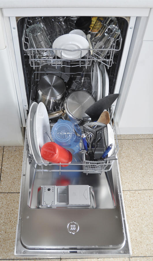 Dishwasher with open hatch and clean dinnerware stock photos
