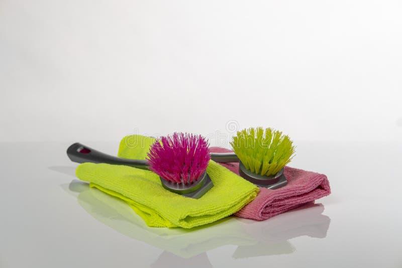 Dishwashing brush green and red stock photo