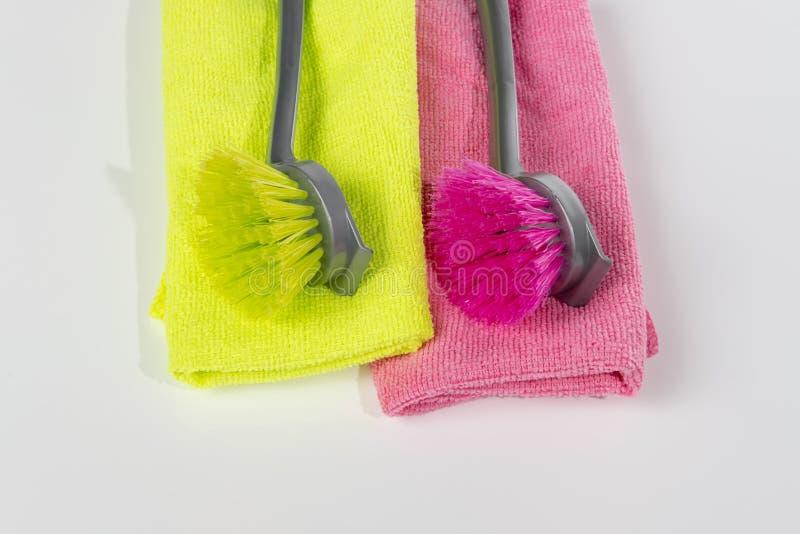 Dishwashing brush green and red royalty free stock photos
