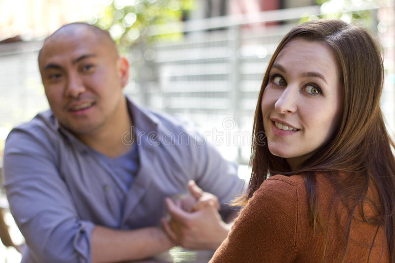 Disinterested Date. Bored incompatible couple on an outdoor date outdoors royalty free stock photography