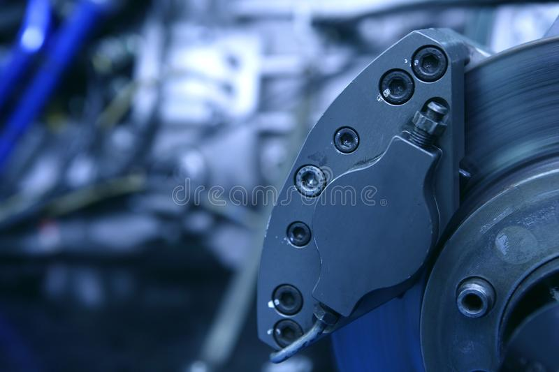 Disk brakes macro detail with engine. For competition royalty free stock image