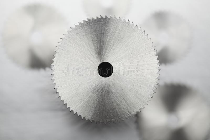 Disk circular saw on gray steel background. Disk circular saw on blurred gray steel background stock image