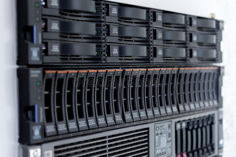 Disk storage drives. Form factor 2.5-inch disk storage drive form factor of 3.5 inches in a single server rack stock photo