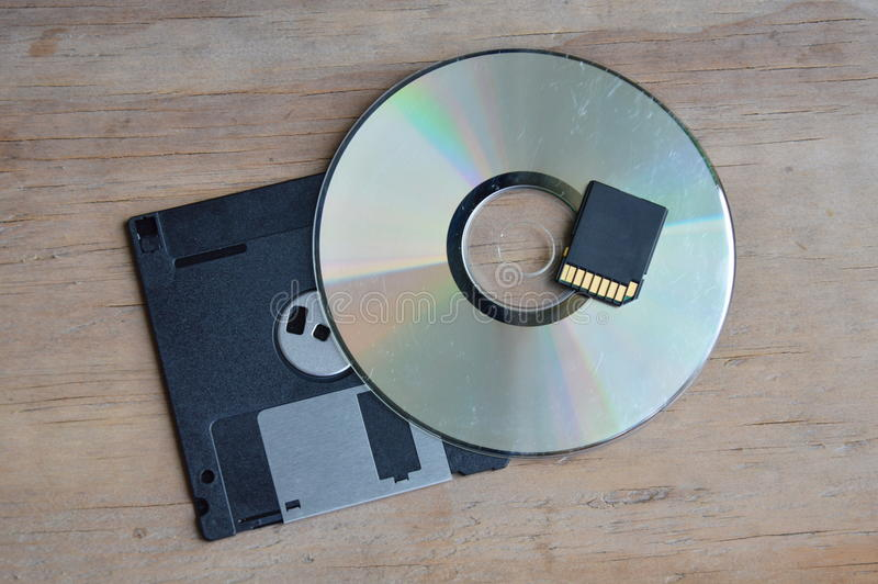 Diskette with DVD and SD card technology development for computer royalty free stock photos