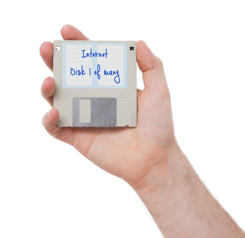 Diskette - Tachnology von der Vergangenheit, lokalisiert auf Weiß stockfotos