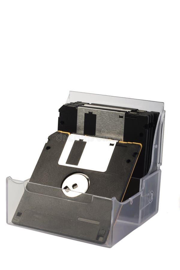 Disketten in einem Kasten lizenzfreie stockfotos