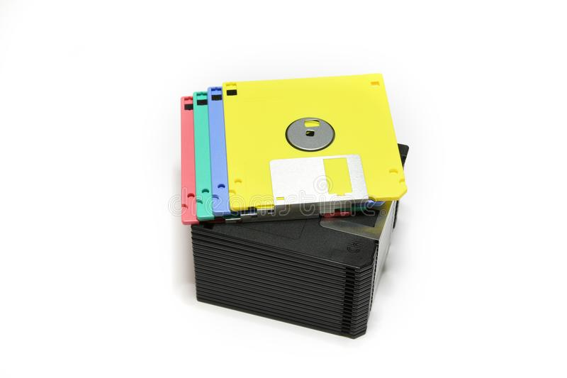 Diskettes coloreadas viejas del ordenador aisladas en el fondo blanco imágenes de archivo libres de regalías
