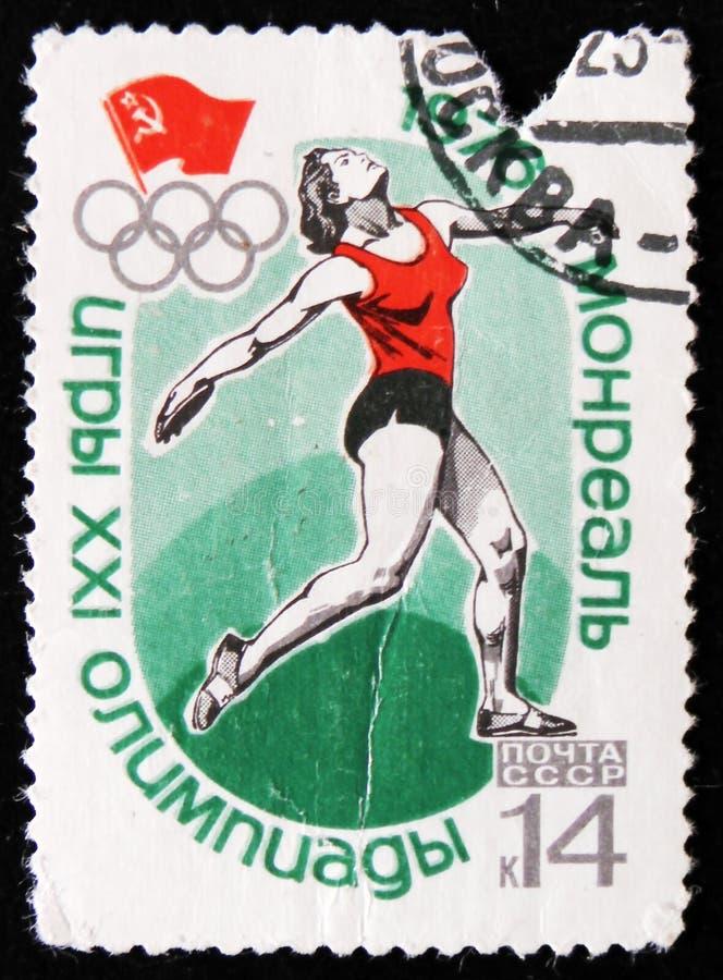 diskus som kastar, olympiska spel i Montreal, Kanada, circa 1976 royaltyfri bild