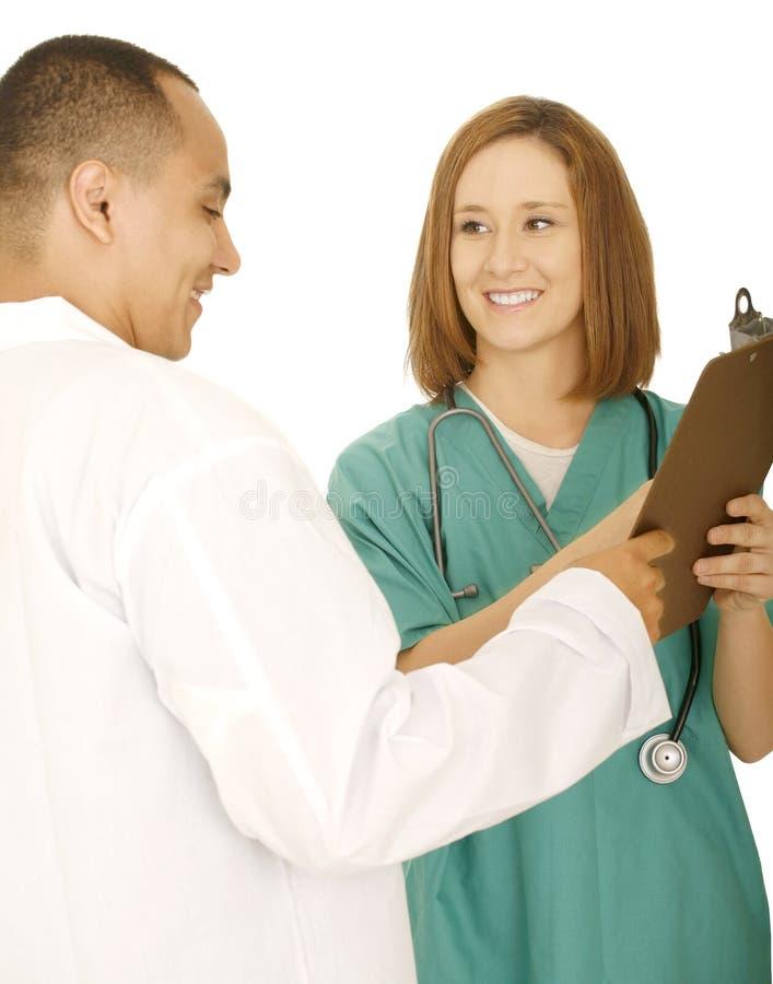 diskutera doktorssjuksköterskarapport royaltyfria bilder