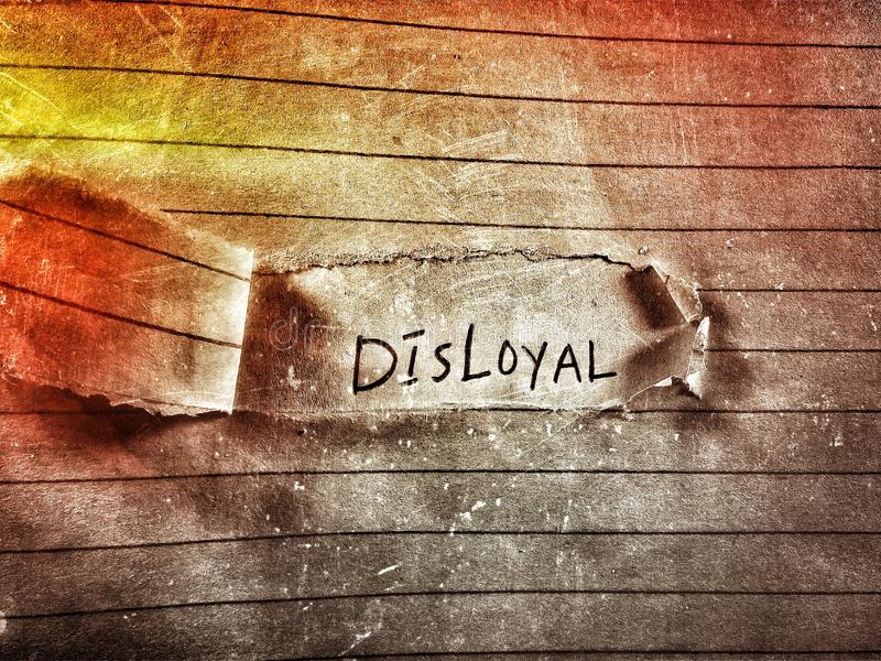 Disloyal word on the fire color rough paper page written by pencil royalty free stock photography