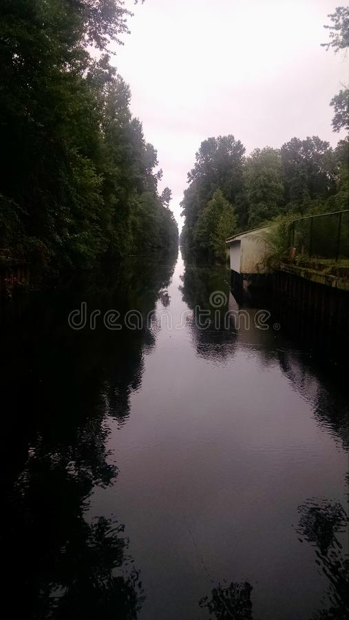 Dismal Swamp Canal, Virginia. Shot of the Canal going away from Lake Drummond stock photography