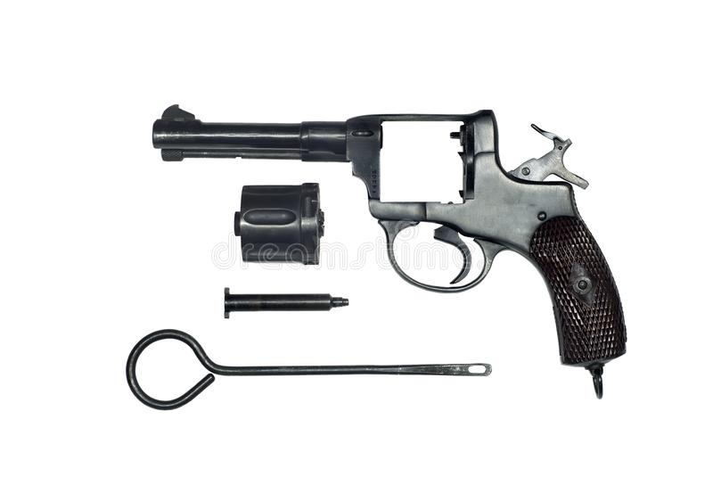 Dismantled vintage revolver isolated. Dismantled vintage revolver with the cylinder removed and the ramrod in the form of separate parts on a white background royalty free stock image
