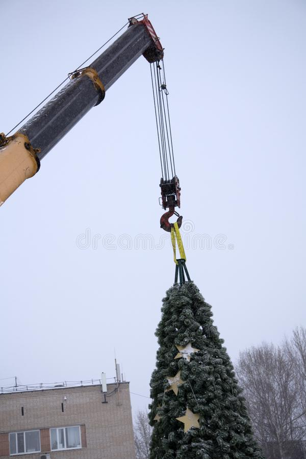 Dismantling the Christmas tree with a machine crane working royalty free stock photo