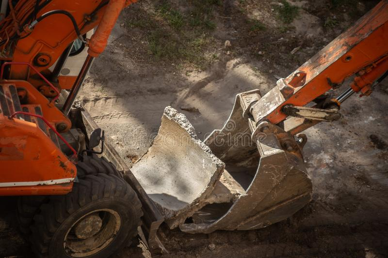 Dismantling of old concrete structures with an excavator. Ladle close-up stock images