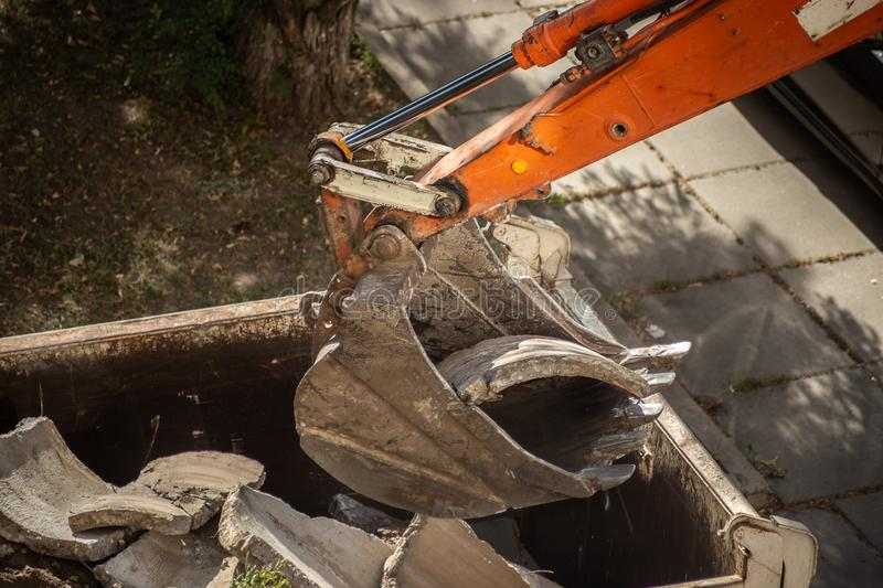 Dismantling of old concrete structures with an excavator. Ladle close-up royalty free stock image