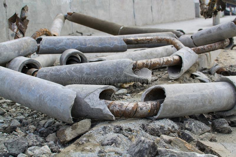 Dismantling of old metal and concrete pipes royalty free stock photos