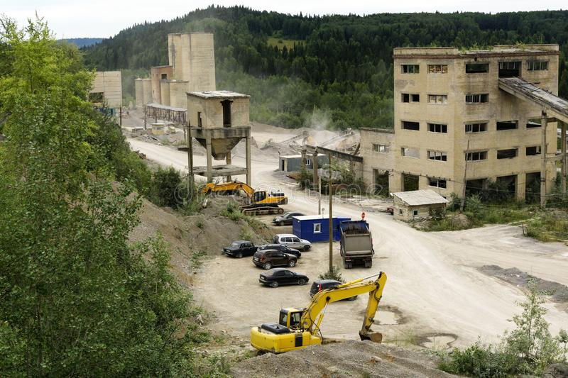 Dismantling of an old cement plant. Dismantling and processing of old cement plant constructions on crushed stone stock photo