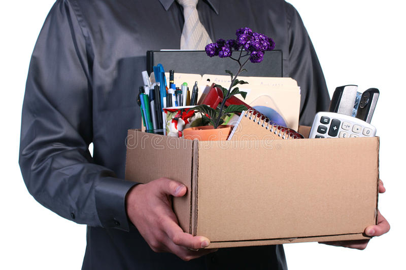 Dismissal. The man has control over a cardboard box with personal office things stock photos