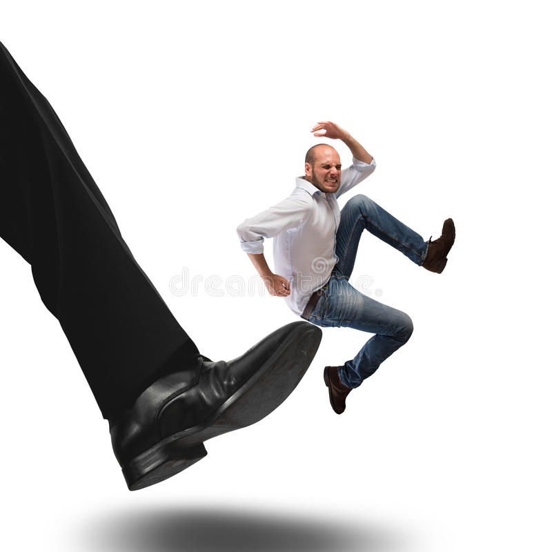 Dismissal employee. Man hit by kick of big foot royalty free stock photos