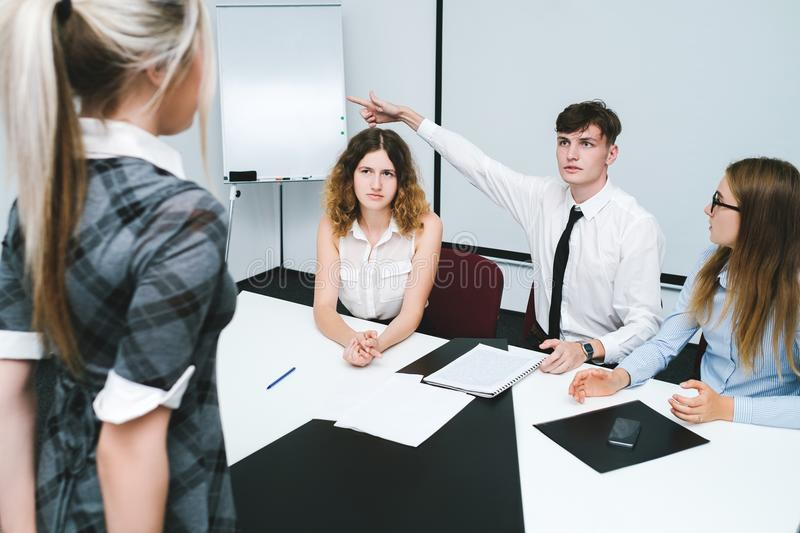 Dismissal guilty office worker woman. Dismissal of a guilty office worker woman. strict bosses. daily routine of working people. kick out gesture stock photos