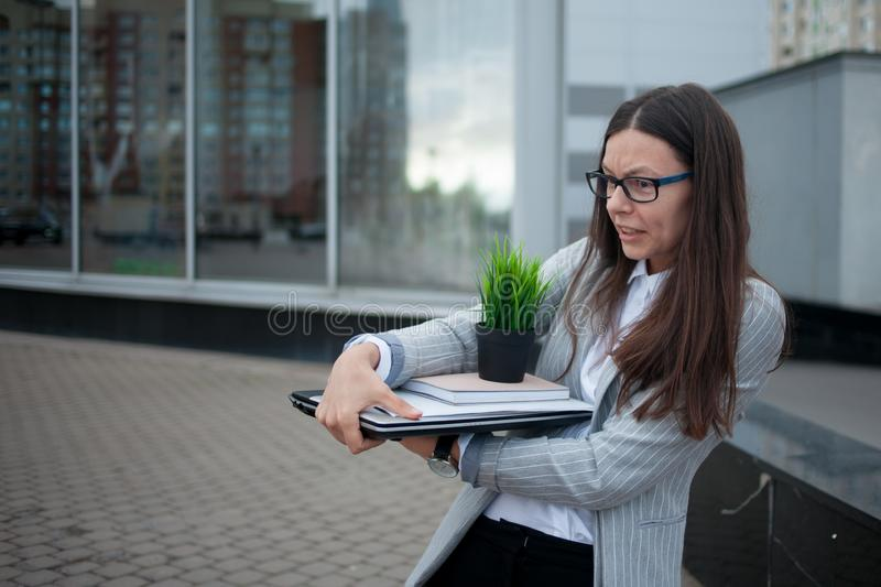 Dismissal from a large company. Economic crisis and problems with qualifications. Dismissal from a company. Economic crisis and problems with qualifications stock photo